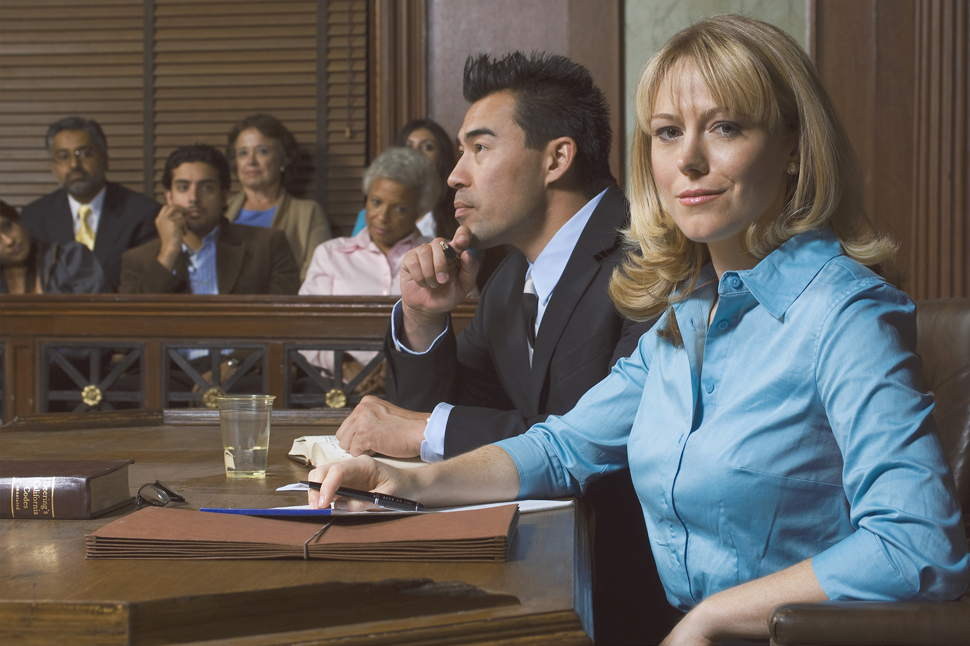 A Female Lawyer in Court representing a previously charged client within Malicious Prosecution litigation